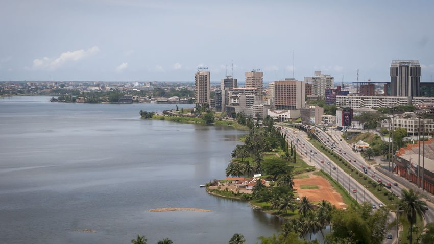 Abidjan, the economical capital of Ivory Coast (Cote d'Ivoire), it's business area Plateau with the Atlantic ocean bay in the background. April 2013